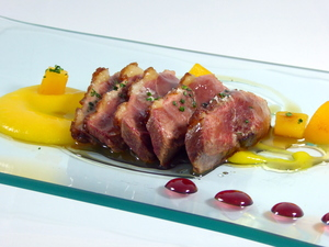 Roasted duck breast with blueberry sauce and peach purée