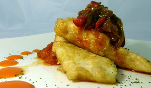 Battered hake with piperrada (roasted green peppers, fried red peppers, onion, garlic and tomato)