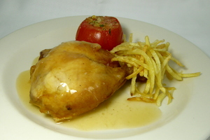 Roast chicken with chips and baked tomatoes