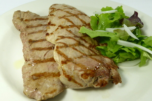 Grilled pork tenderloin with salad