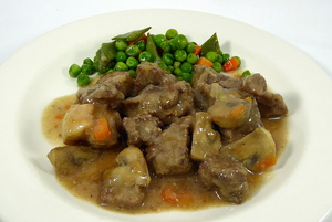 Beef stew seasoned with thyme and diced vegetables