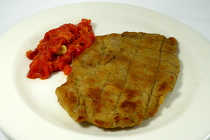 Grilled veal escalope with red pepper stew