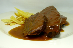 Veal cheeks stew seasoned with Pedro Ximenez and garnished with potatoes
