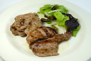 Grilled turkey chop with lettuce salad