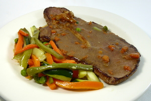 Veal steak served with mixed vegetables