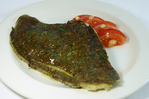 Grilled turbot with tomato and garlic salad