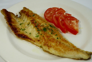 Grilled sea bass with tomato and garlic salad