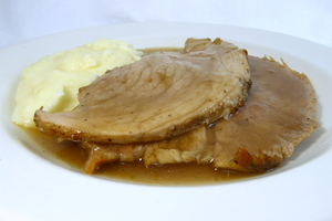 Roasted ham with mustard gravy and mashed potatoes