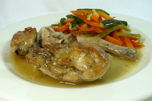 Rabbit seasoned with mustard stew and garnished with mixed vegetables