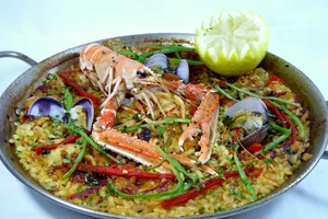 Paella with langoustines, clams, rabbit and squid