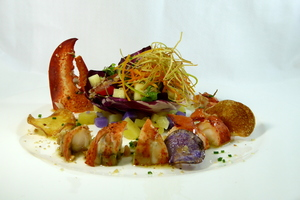 Lobster and potato salad with dried fruit and nut vinaigrette