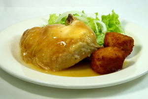 Roasted chicken with croquettes and salad