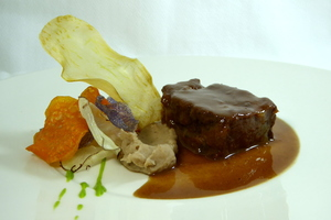 Braised veal cheeks with chestnut purée and vegetable chips