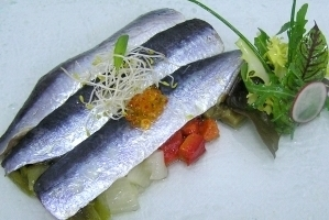 Sardines marinated with ginger and escalibada (grilled vegetable salad)