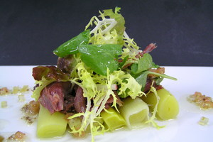 Duck confit thigh and leaks warm salad with an ancient mustard vinaigrette