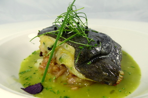 Turbot stuffed with vegetables and served with clam sauce