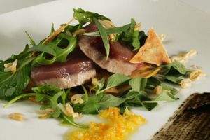 Warm marinated albacore salad with citrus fruits vinaigrette