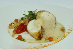 Roasted monkfish with tomato marmalade and fresh germinated salad