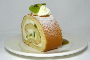 Kiwi and whipped cream sponge cake roll