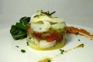 Cod cake with piperrada (roasted green peppers stew)
