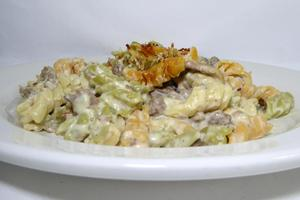 Spiral shaped Italian pasta with minced meat and Mornay sauce