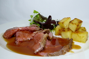 Roasted veal with rissolé potatoes and green salad