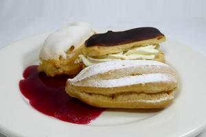 Éclairs filled with  patissiere cream and whipped cream