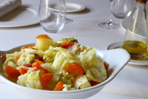 Boiled cabbage with baked potato