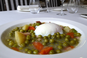 Pea, carrot, potato and leek stew with poached egg