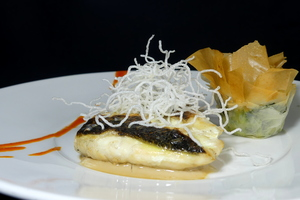 Roasted sea bass with txakolí wine sauce