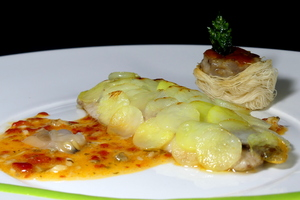 Mackerel fillets covered by potato flakes