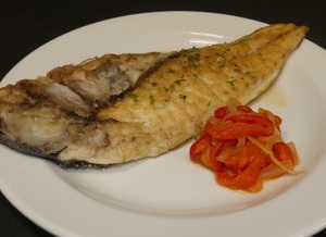 Grilled gilt–head bream with red pepper and onion stew