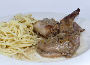 Rabbit seasoned with mustard stew and garnished with spaghetti