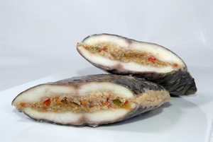 Organic tilapia stuffed with quinoa and vegetables with mussels sauce