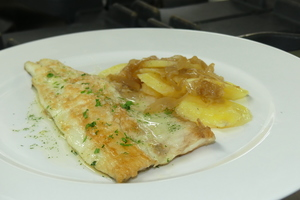 Grilled sea bass with golden potato rounds