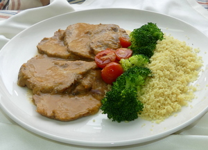 Braised pork loin with mixed vegetables and couscous