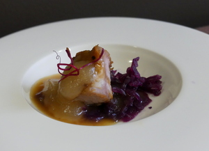 Lacquered bacon, red cabbage sauerkraut and reineta apple