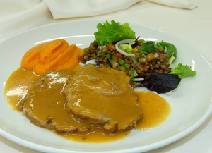 Roasted pork with pumpkin purée and lentil salad