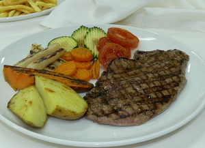 Beef steak with grilled vegetables potato and baked sweet potato