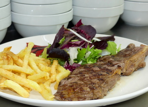 Grilled rib eye with salad, piquillo peppers and French fries