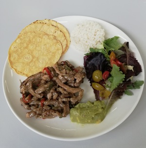 "Roasted pork ""mexican tacos"" with vegetables, guacamole and rice"